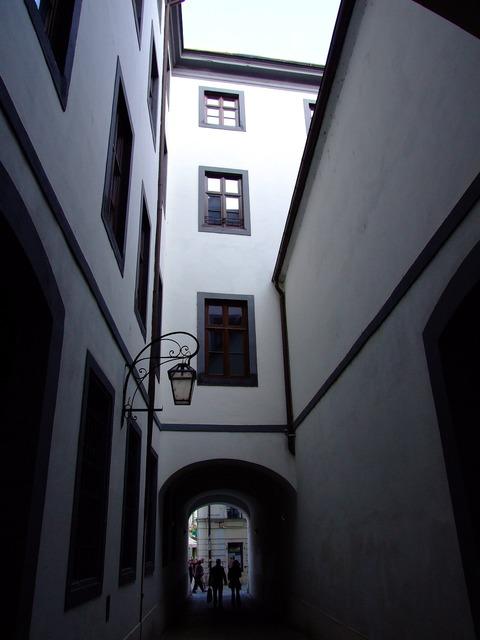 Courtyard street architecture, transportation traffic.
