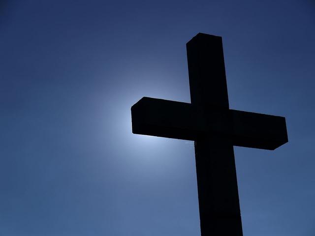 Cross against light, religion.