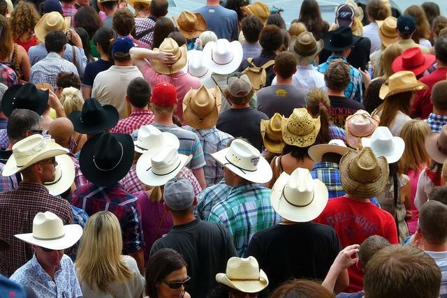 Crowd heads hats.