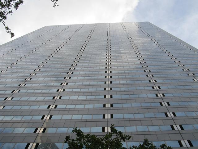 Dallas skyscraper glass facade, business finance.