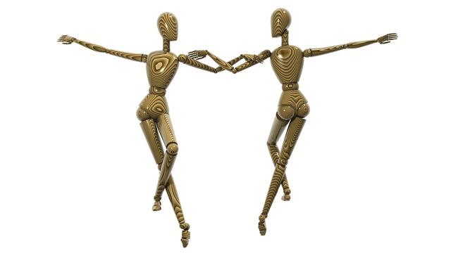 Dancing couple wooden effigies effigy.