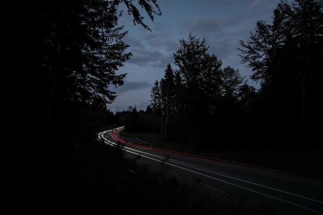 Dark light streaks road, transportation traffic.