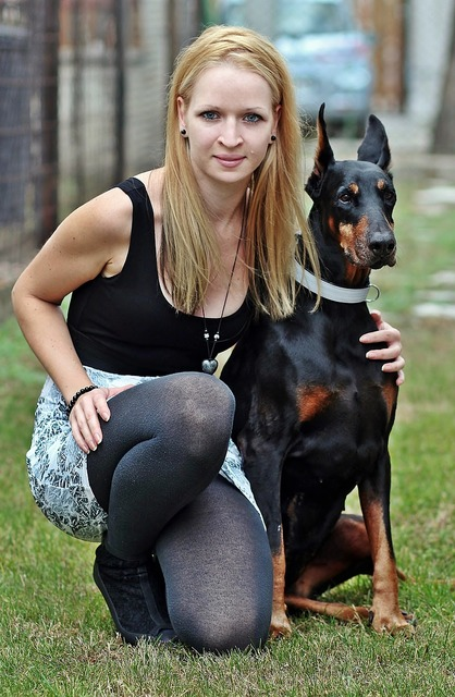 Doberman blonde woman friendship, emotions.