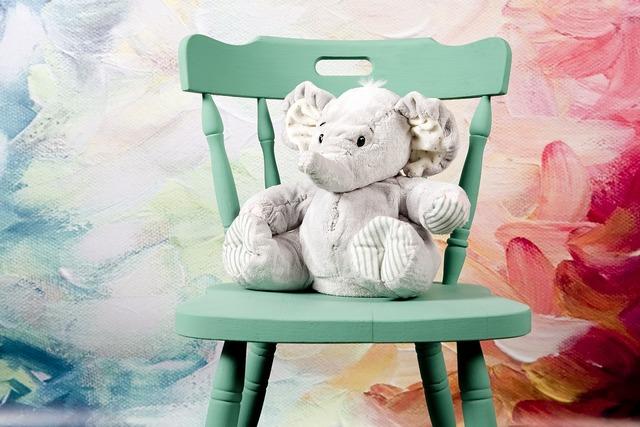 Elephant sitting plush.