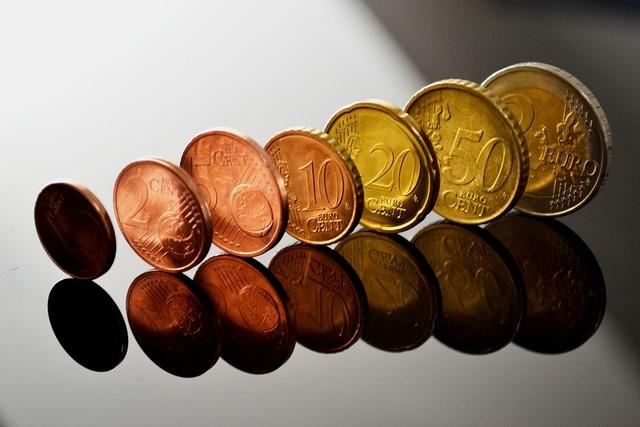 Euro coins specie mirroring, business finance.
