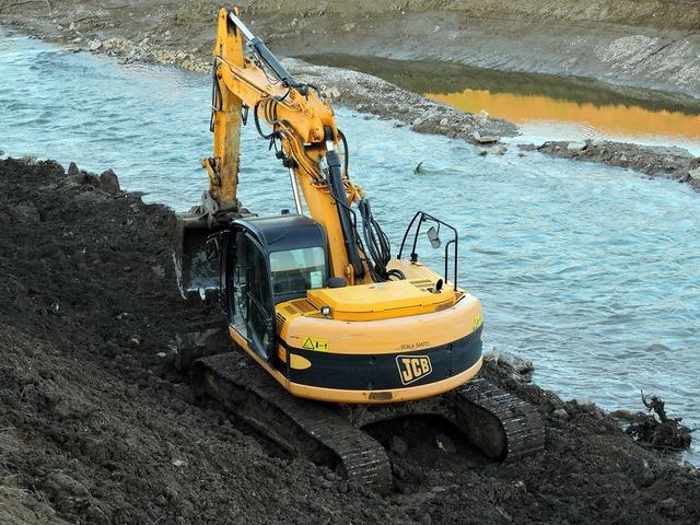 Excavator river torrent.