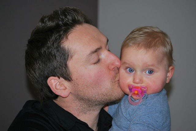 Father with child baby kiss, emotions.