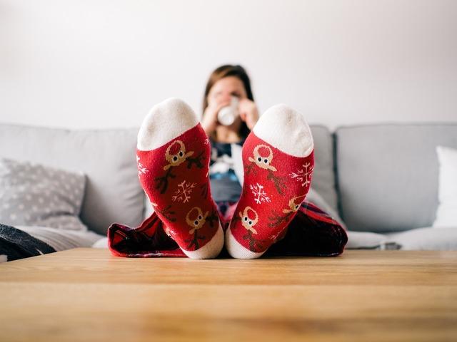 Feet socks living room, people.