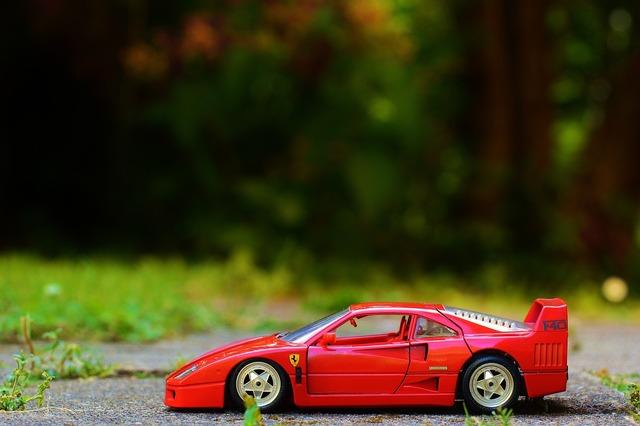 Ferrari red auto, transportation traffic.