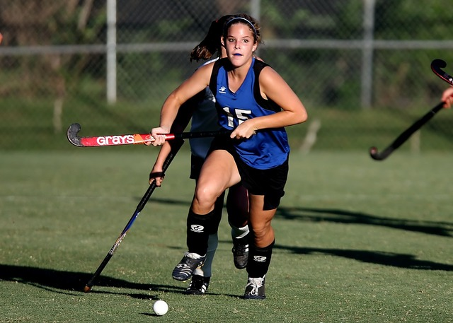 Field hockey game action, sports.
