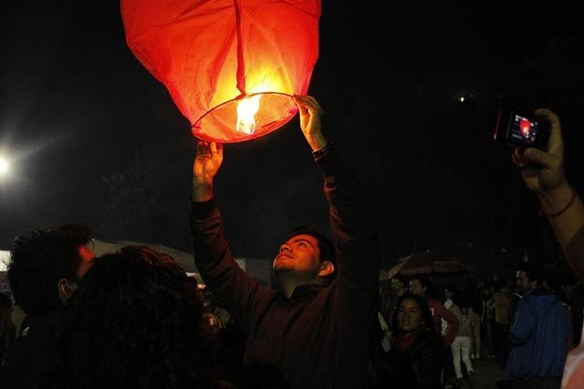 Fire lantern dark, people.