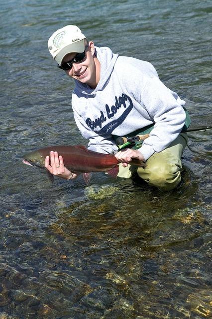 Fisherman fishing salmon, sports.