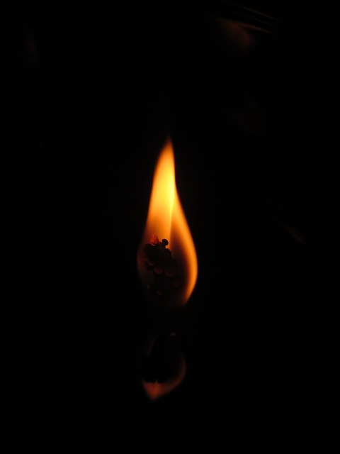 Flame candle dark.