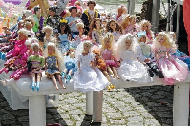 Flea market dolls toys.