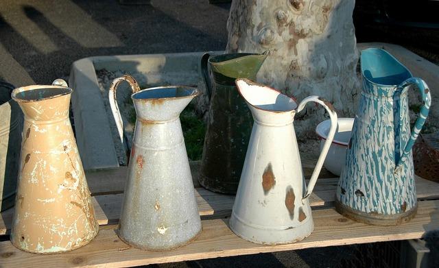 Flea market jug for water metal enamelled.