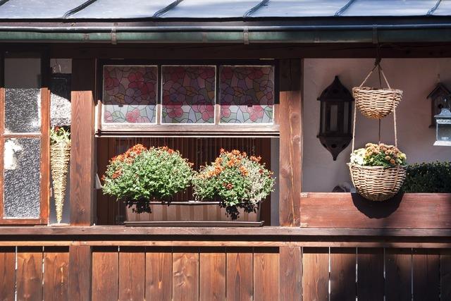 Flower boxes balcony window sill.