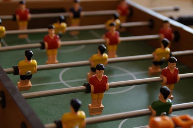 Foosball table football figures, sports.