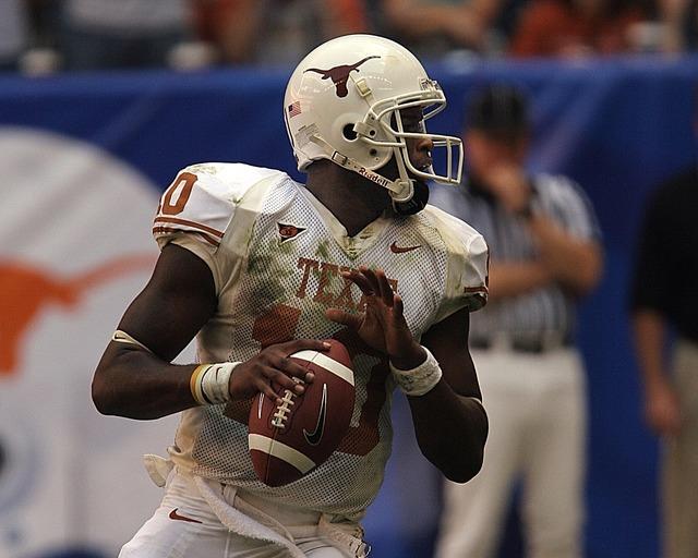 Football quarterback action, sports.