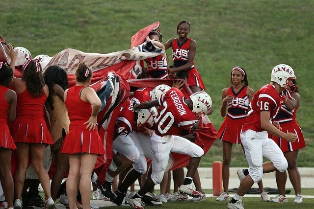 Football team cheerleaders pre-game, sports.