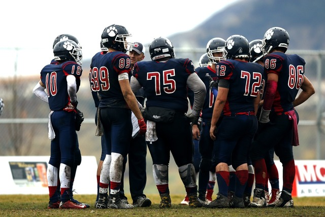 Football team huddle teamwork, sports.