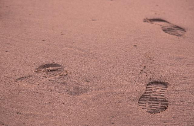 Footprints leg sand, travel vacation.