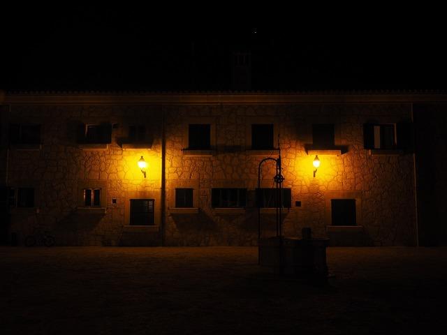 Fountain at night illuminated, architecture buildings.