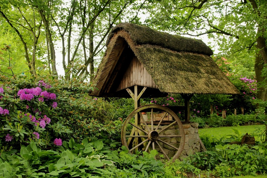Fountain thatched roof wagon wheel.