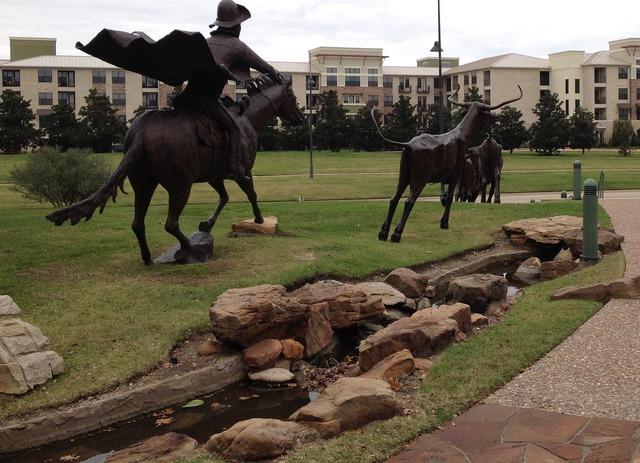 Frisco tx longhorn sculpture cowboy.