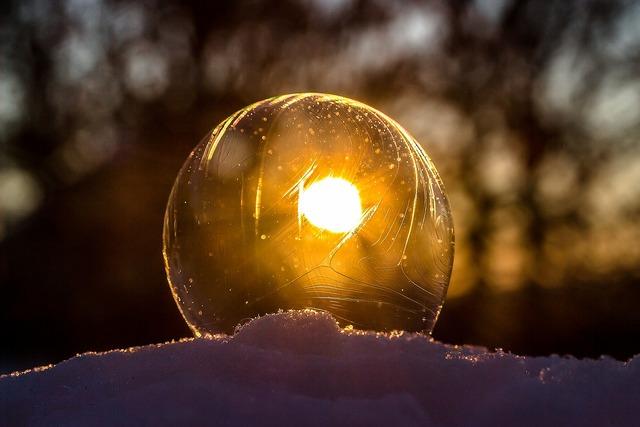 Frozen bubble soap bubble slightly frozen, nature landscapes.