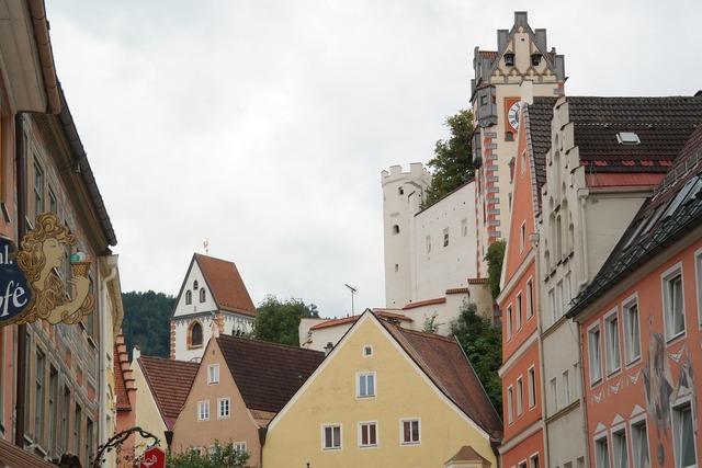Füssen old town downtown, architecture buildings.
