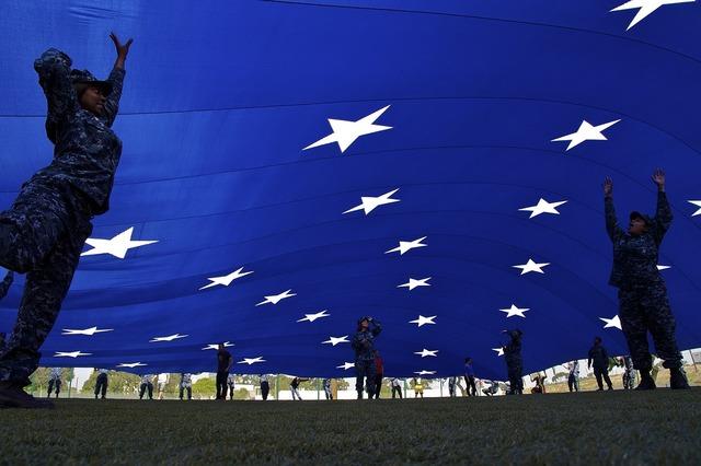 Giant flag teamwork people, people.