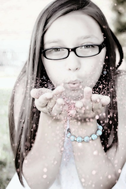 Girl blowing glitter face portrait, beauty fashion.