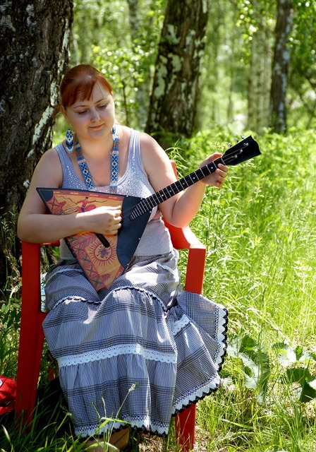Girl with balalaika musical instrument russian folk clothes, people.
