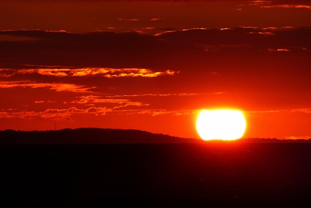 Glowing red sunset, travel vacation.