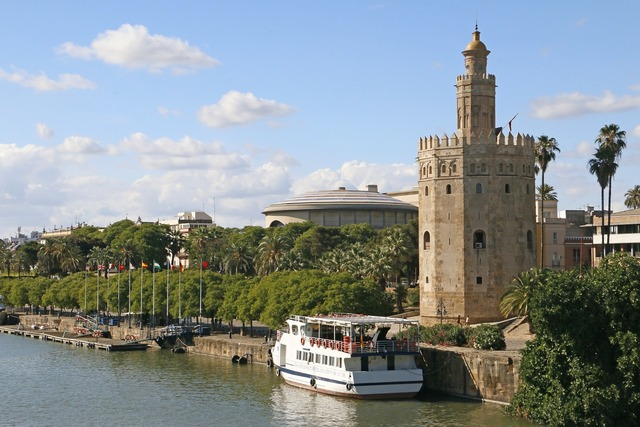 Gold tower seville river.