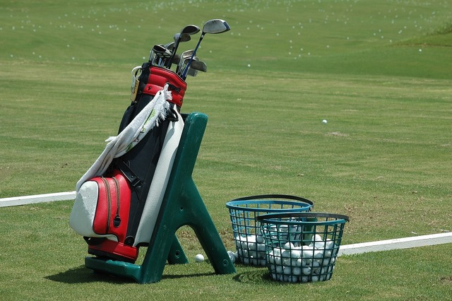 Golf bag clubs ball, sports.