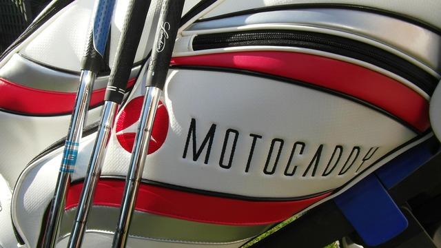 Golf golf bag golf clubs.