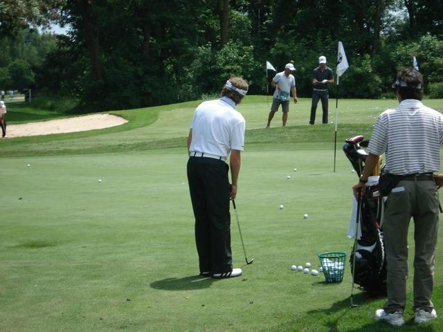 Golf golfers golf course.