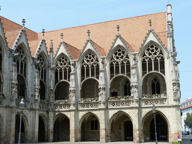 Gothic town hall facade, architecture buildings.