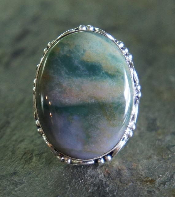 Green jasper ring silver metal.