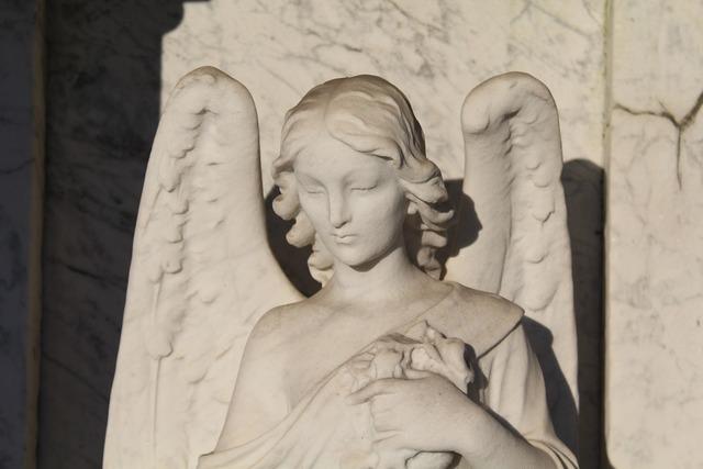 Guardian angel angel statue.