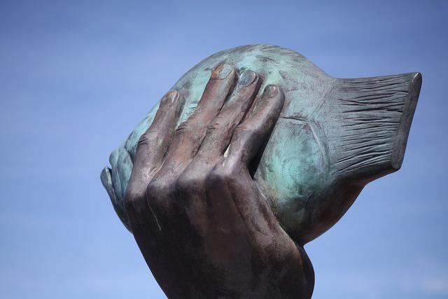 Hand butt sculpture.