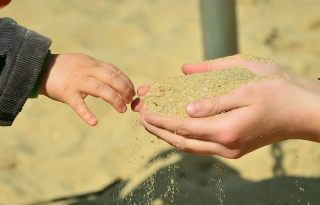 Hands sand children's hands, travel vacation.