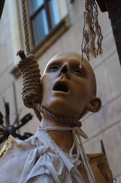 Hangman puppet corpse, places monuments.