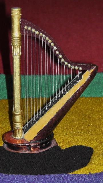 Harp plucked string instrument figure, music.