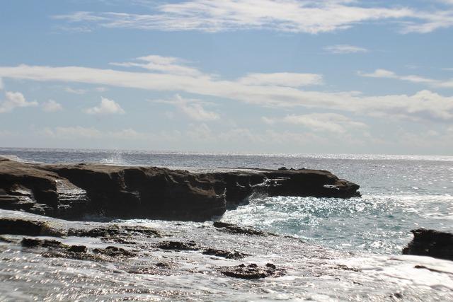 Hawaii beach big rock, travel vacation.