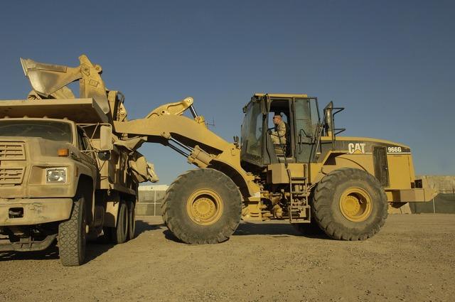 Heavy equipment loader construction, transportation traffic.