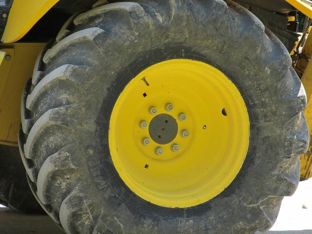 Heavy equipment wheel tire machinery, architecture buildings.