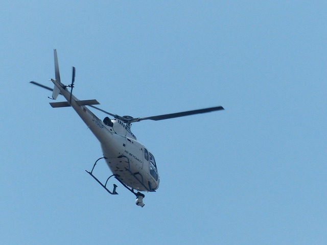 Helicopter monitoring surveillance camera.