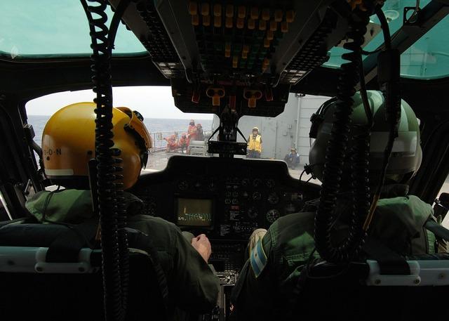 Helicopter pilots cockpit preparations.